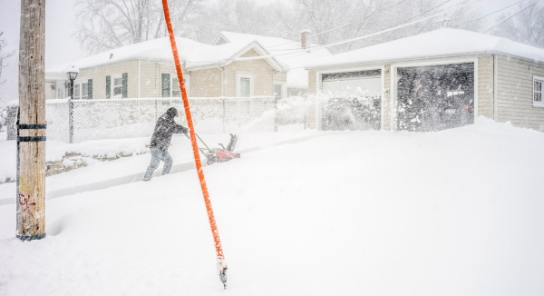 Clearing the driveway during a blizzard